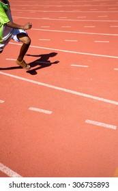 Kid runing on track in the Stadium