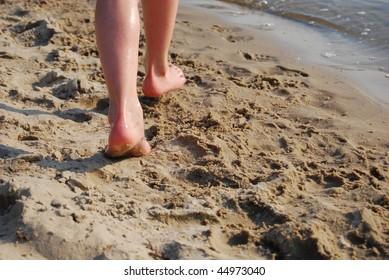 kid running on the beach. fragment