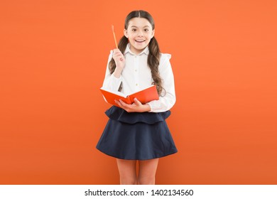 Kid school uniform hold workbook. School lesson. Child doing homework. Your career path begins here. Inspiration for study. Back to school. Knowledge day. Possible everything. Schoolgirl enjoy study.