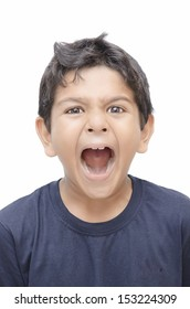 Kid screaming with mouth wide open.