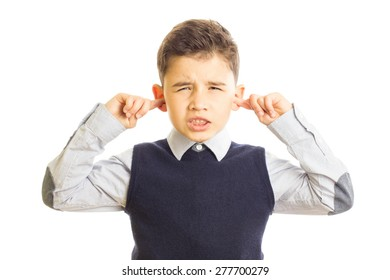 A kid screaming and putting his fingers in ears because of the noise