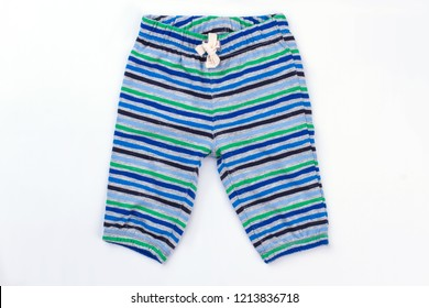 Kid shirts with horizontal colourful stripes. Striped child pants on white isolated background.