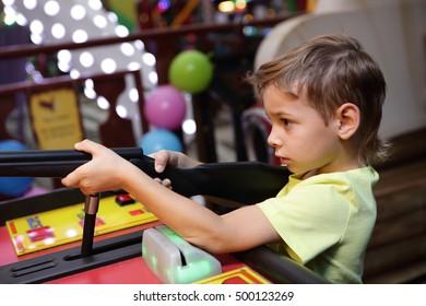 Kid shooting a rifle in an amusement park