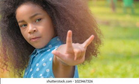 kid show love sign hand in the park