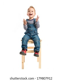 Kid sitting and clapping over white background