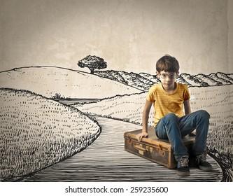 Kid sitting on his suitcase