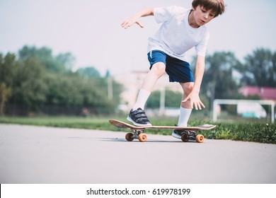 Kid skateboarder doing a skateboard trick.