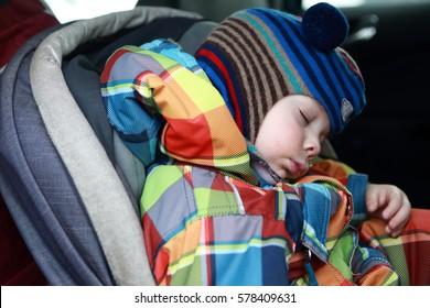 Kid sleeping in a child car seat