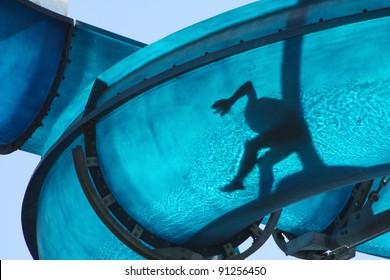 Kid sliding a blue Waterslide