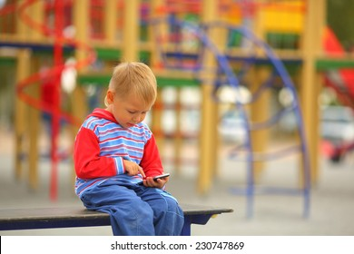 kid with a smartphone