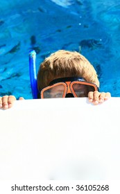 kid with a snorkeling mask showing only eyes