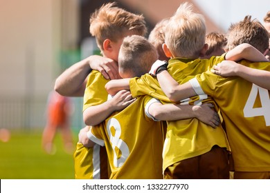 Kid Soccer Football Team Huddle. Children Play Sport Game. Children Sporty Team United Ready to Play Game. Youth Sports For Children. Boys in Sports Jersey Red Shirts. Young Boys in Soccer Sportswear