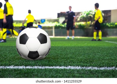 Kid soccer practice drills with cones. Soccer drills: slalom drill. Young football players training on pitch