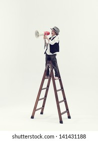 Kid speaking with megaphone on top of a ladder