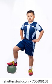 Kid in sportswear make a football gesture on white background.