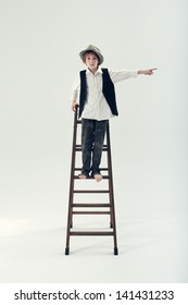 Kid standing on a ladder and pointing