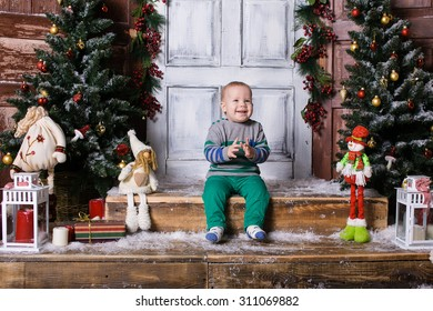 The kid in the studio with Christmas decorations
