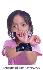 kid with taped mouth and hand, begging for help. Sad, abuse girl. Violence, despair.