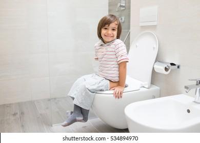 Kid at toilet