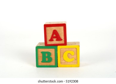 kid toy blocks spelling ABC on white background