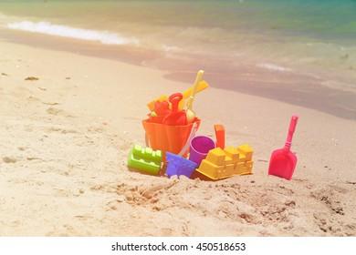 kid toys on tropical sand beach