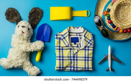Kid travel objects concept on blue background