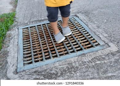 kid walking on water drain cap
