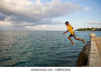 A kid want to jump on the water in Binongko Island, Wakatobi, Southeast Sulawesi on Mei 13, 2017