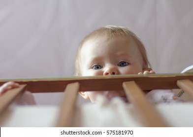 kid watching from the cradle