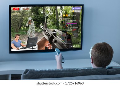 Kid Watching Live Game Streaming Session On TV Screen