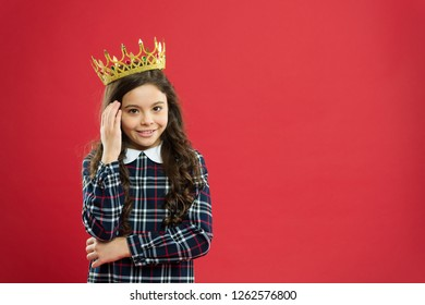 Kid wear golden crown symbol of princess. Every girl dreaming to become princess. Lady little princess. Girl wear crown red background. Monarch family concept. Princess manners. Monarch attribute.