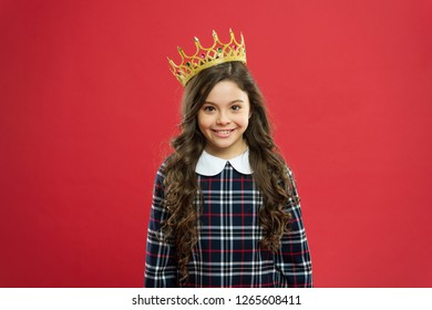 Kid wear golden crown symbol princess. Every girl dreaming become princess. Lady little princess. Girl wear crown red background. Spoiled child concept. Egocentric princess. World spinning around me.
