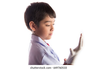 Kid wearing doctor glove for protection