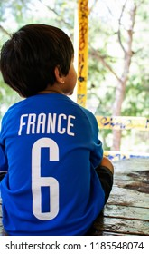 Kid wearing a French's football jersey with the number 6.