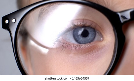 Kid wearing glasses closeup, childhood eye diseases, ophthalmology concept