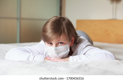 Kid wearing protection face mask  during corona virus. Frightened  kid stay at home due to quarantine