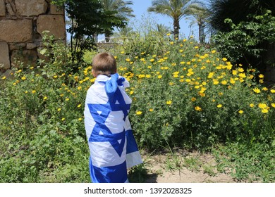 kid wrapped in the flag of Israel