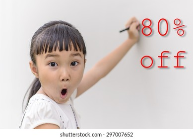 Kid write on wall with surprise face for 80 percent discount