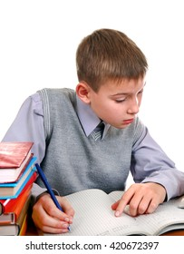Kid writing at the School Desk on the White Background