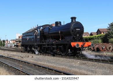 KIDDERMINSTER, ENGLAND - SEPTEMBER 19, 2019: Steam locomotive in action at the station area in Kidderminster, England
