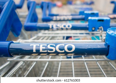 Kidderminster, UK - March 2017: Tesco supermarket trolleys stacked in a line.
