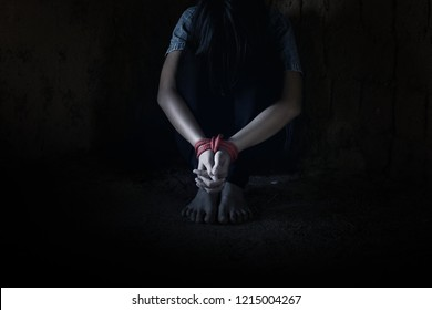 Kidnapped little girl tied with rope.Abused and tortured concept. Human trafficking concept. Stop violence against Women. International women's Day. Stop abusing violence.