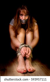 175db6b7fc0cc5 Kidnapped woman tied with rope isolated on black - violence concept