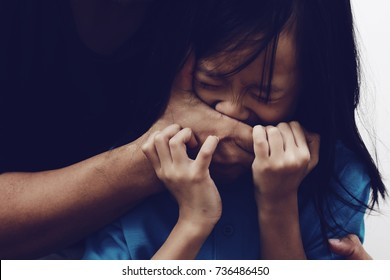 Kidnapping. Hand of unknown man covering scared Asian child face. Child abuse concept