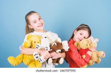 Kids adorable cute girls play soft toys. Happy childhood. Child care. Sisters best friends play. Sweet childhood. Childhood concept. Softness and tenderness. Charity sale. Love and friendship.