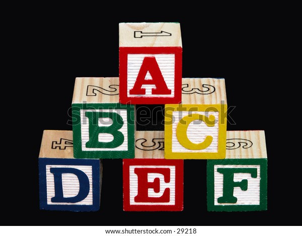 Kids alphabet blocks (a-f) on black.