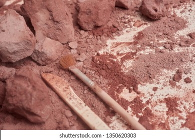 Kid's archaeology tool and brush on a sandy environment. It is the popular archaeology tool kit toy for educational purposes.