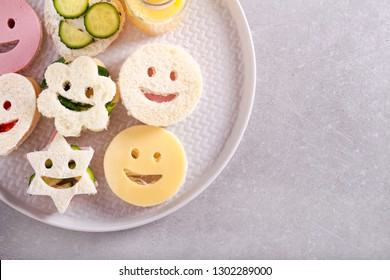 Kids assorted funny sandwiches on plate