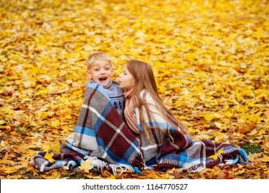 kids autumn play, kids have fun playing in the Park in yellow leaves, little boy and girl