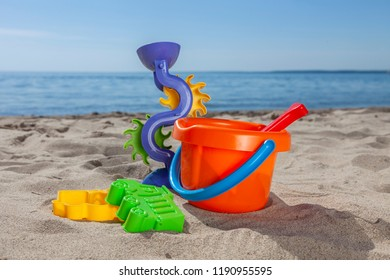 kids beach toys on sand in sunny day